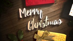 Animated closeup Merry Christmas text, gift boxes and green tree branches stock footage