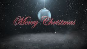 Animated closeup Merry Christmas text and white snowflakes, red balls stock footage