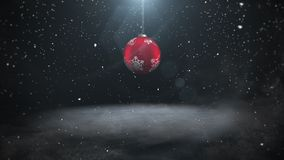 Animated closeup white snowflakes and red balls on dark background stock video footage