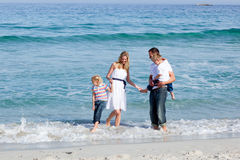 Animated family having fun at the beach royalty free stock images
