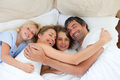 Animated family hugging in the bedroom stock image