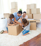 Animated family packing boxes Royalty Free Stock Photo