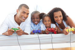 Animated family playing video game Royalty Free Stock Photos