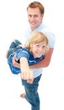 Animated father giving his son piggyback ride Stock Images
