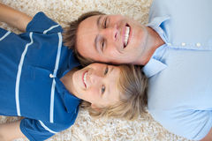 Animated father and his son lying on the floor Royalty Free Stock Image