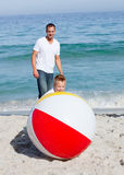 Animated father and his son playing with a ball. At the beach Royalty Free Stock Photo