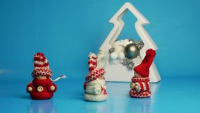 Animated figures in winter wear dancing before Christmas decoration. stock video