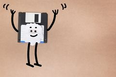 Animated floppy disk concept. Stick and walk figure jumping royalty free stock photo