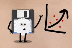 Animated floppy disk concept. Stick and walk figure explaining graph royalty free stock photos