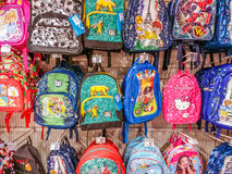 Animated preschool and school backpacks in supermarket Royalty Free Stock Photos