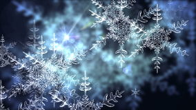 Animated snowflake drop from the winter sky stock footage