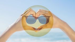Sunglasses Smiley and heart with hands stock video footage