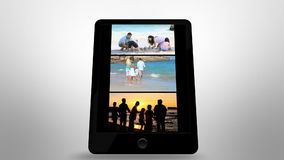 Animated tablet computer showing family having fun stock footage