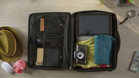 Animated things quickly filling suitcase, bag leaving room, top view stop-motion. Stock footage stock footage