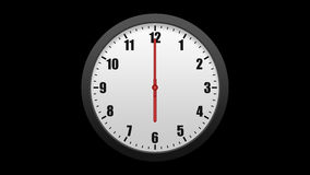 Animated wall clock, isolated on a black background. Including alpha matte. stock video