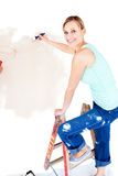 Animated woman painting a room Stock Images