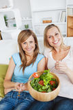 Animated women eating a salad Stock Photos