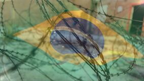Barbed wires against Brazil flag