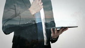 Animation of businessman holding a tablet stock footage