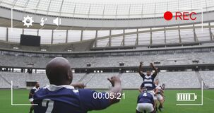 Animation of a camera screen over two multi-ethnic rugby teams playing rugby
