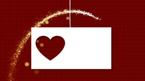 Animation of card with carved heart Valentines Day. Ard with space for text on thread falls from top. There are red background with hearts and gold sequins stock video footage