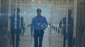 Man walking in server room with moving data security messages. Animation of a Caucasian man walking down a corridor between mainframe computer towers in a server stock video