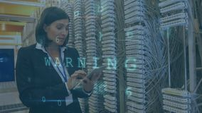 Woman working in server room with moving data security messages. Animation of a Caucasian woman seen from the waist up checking the equipment in a server room stock video