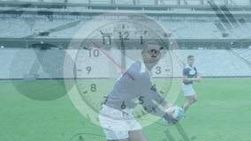 Animation of clock ticking, graphs rolling over two multi-ethnic rugby teams playing rugby
