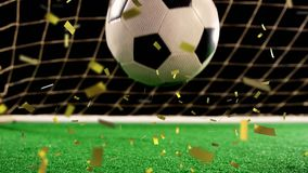 Football in front of a goal with confetti falling. Animation of a close up of a football bouncing on a football pitch in front of a goal with golden confetti vector illustration