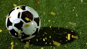 Football on grass with confetti falling. Animation of a close up of a football placed on a football pitch with golden confetti falling stock illustration