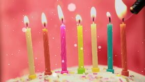 Animation of dots flying over lighter and birthday candles