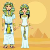 Animation Egyptian imperial family in ancient clothes. Full growth. Background - the desert, the Egyptian pyramids. Stock Photos