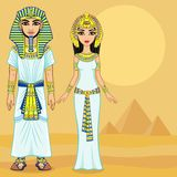 Animation Egyptian imperial family in ancient clothes. Full growth. Background - the desert, the Egyptian pyramids. Royalty Free Stock Photos