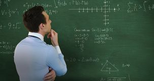 Back view of man thinking in front of moving maths calculations on chalkboard 4k