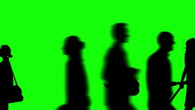 Animation of a large crowd crossing 4K video. Silhouette version. Close-up view. green background for background transparent use