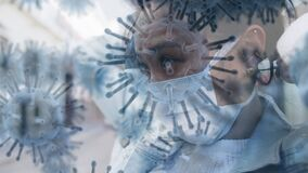 Animation of macro coronavirus Covid-19 cells spreading over an Asian woman putting on a mask