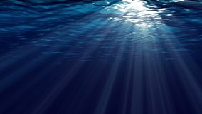 Animation of ocean waves from underwater.  Marine background. Realistic underwater Scene with sun rays and nice glowing light stock video footage