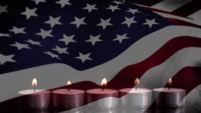 US flag and candles