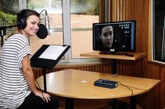 Animation Voice Actress at Recording Studio. Portuguese actress Joana Santos in studio, giving voice to Jodie Holmes, one of the two player characters in the new Royalty Free Stock Image