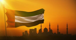 Animation waving fabric texture of the flag with color of united arab emirates at sunset with sun rays light, uae on mosque. Silhouette in background stock footage