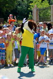Animator in the costume of the dog entertain the children Royalty Free Stock Image