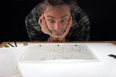 Animator. Worker of the cartoon animation industry on lightbox stock photo