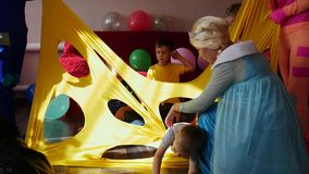 Animators entertain children with games. A children`s party. The work of the animators. Close up stock video footage