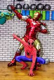 Animators iron man and spider-man in the fitness room stock photos