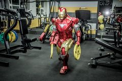 Animators iron man and spider-man in the fitness room royalty free stock image