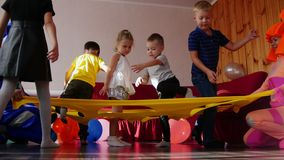 The animators put on a show and entertain children with toys. A children`s party. Close up stock video
