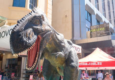 Animatronic dinosaur on display in Adelaide, South Australia. Adelaide, Australia - January 6, 2017: A mechanical Tyrannosaurus Rex model delights onlookers in Stock Photography