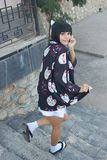 Anime girl with a black hair. In asian background stock photos
