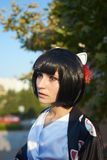 Anime girl with a black hair. In asian background royalty free stock photography