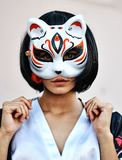 Anime girl with a black hair. In asian background royalty free stock photos